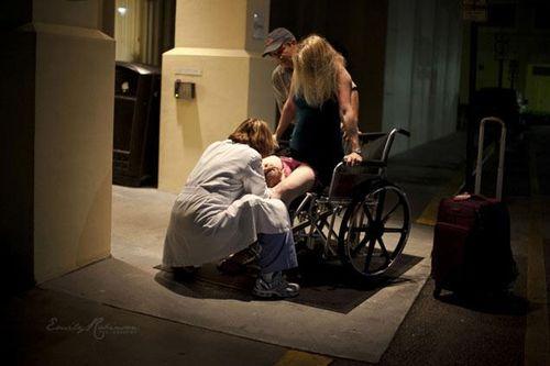 Parint en una cadira de rodes